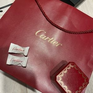 Carter ring box (empty) and large cartier bag